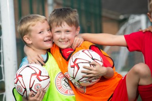 Two young players hugging - summer camp 2016